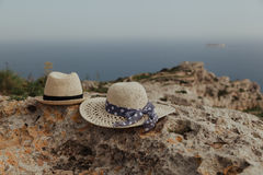 Two hats on vacation in mountains. Romantic vacation in nature - two hats on vacation in mountains Stock Photos