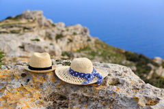 Two hats on vacation in mountains. At the sea Royalty Free Stock Photography
