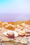 Two hats on vacation in mountains. At the sea, mountains vacation concept Stock Photos