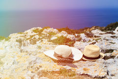 Two hats on vacation in mountains. At the sea, mountains vacation concept Stock Image