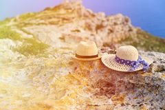 Two hats on vacation in mountains. At the sea, mountains vacation concept Royalty Free Stock Images