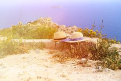 Two hats on vacation in mountains. At the sea, mountains vacation concept Stock Photo