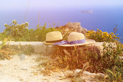 Two hats on vacation in mountains at the sea. Mountains vacation concept Stock Image