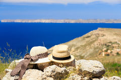Two hats on vacation in mountains. At the sea, romantic vacation Stock Photography