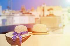Two hats on vacation in urban Europe. Luxury vacation concept Stock Images