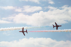 Two Hawk T1 jets on air show. Air show, two Hawk T1 jets with colored smoke on air show Stock Photography