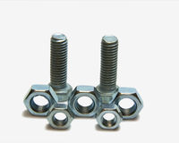 Two head bolts and five nuts Royalty Free Stock Photography