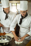 Two head chef making pizza dough Stock Photos
