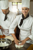 Two head chefs making pizza dough Royalty Free Stock Images
