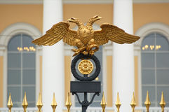 Two-headead eagle. Golden russian two headed eagle on top of a metal door stock photography