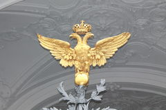 The two-headed eagle. The double-headed Golden eagle of the winter Palace Royalty Free Stock Photo