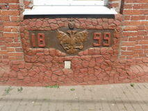 The two-headed eagle on the wall of the building in 1899, a rarity. Bobruisk, Belarus - June 4, 2016: The two-headed eagle on the wall of the building in 1899, a Royalty Free Stock Photography