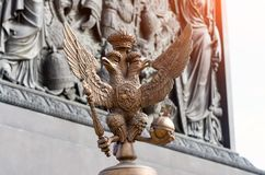 Two-headed eagles on the fence around the pillar of Alexandria, on Palace Square In Saint Petersburg. Two-headed eagles on the fence around the pillar of Royalty Free Stock Photography