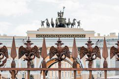 Two-headed eagles on the fence around the pillar of Alexandria, on Palace Square In St. Petersburg. Two-headed eagles on the fence around the pillar of Stock Image