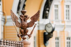 Two-headed eagles on the fence around the pillar of Alexandria, on Palace Square In St. Petersburg. Two-headed eagles on the fence around the pillar of Stock Photo