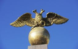 Two headed golden eagle obelisk in the market square in Helsinki Royalty Free Stock Photos