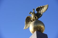 Two headed golden eagle obelisk in the market square in Helsinki Stock Photography