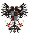 Two-headed heraldischer Adler mit einem Schild Stockfotografie