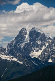 Two-headed peak. Views of Mount Ushba from Mount Tetnuldi. Svanety Royalty Free Stock Photo