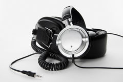 Two headphones on white background. Two, stereo, high quality headphones  on white background Royalty Free Stock Photos