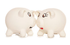 Two heads together are better than one piggy banks Royalty Free Stock Photos