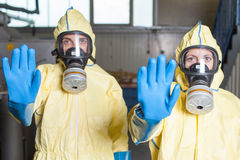 Two health workers warn of Ebola. Two aid workers prohibit access Stock Photos
