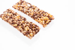 Two healthy granola bar muesli or cereal bar isolated on white. Background Royalty Free Stock Image