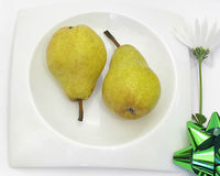Two healthy pears on white plate Stock Images
