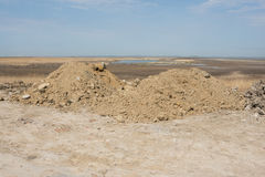 Two heaps of earth with small amount of construction waste Stock Photo