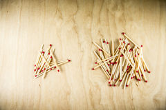 Two heaps of matches Royalty Free Stock Photos