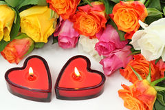 Two heart candles and roses Stock Images