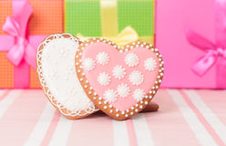 Two heart cookies and presents Royalty Free Stock Photos
