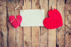 Two heart hanging and paper on clothesline and rope with wooden Royalty Free Stock Photography