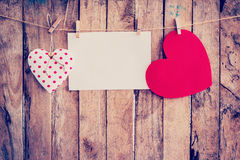 Two heart hanging and paper on clothesline and rope with wooden Stock Photography