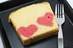 Two heart in one butter cake. On a black dish Royalty Free Stock Photo