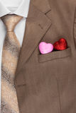 Two Heart peeps out of the pocket of his jacket Stock Photos