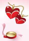 Two heart pendants and red box Royalty Free Stock Image