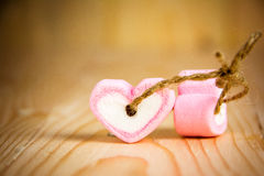 Two heart shape marshmallow pink for love stock photography
