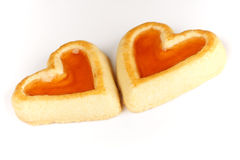 Two heart shaped apricot jam biscuits Royalty Free Stock Photos