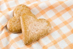 Two heart shaped biscuits Stock Photography