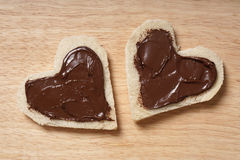 Two heart shaped bread slices with chocolate stock image