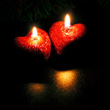 Two heart-shaped candles Stock Image