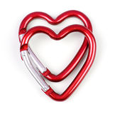 Two heart shaped carabiner one above the other Stock Photos