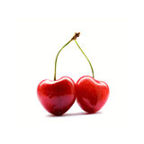 Two heart-shaped cherries Stock Photos