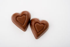 Two Heart Shaped Chocolates Royalty Free Stock Photography