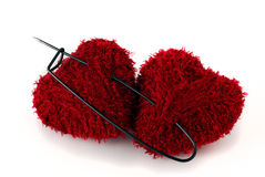 Two heart shaped clews pinned with huge pin Royalty Free Stock Photography