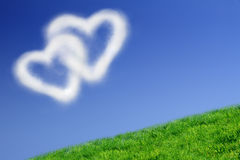 Two heart-shaped clouds royalty free stock photos