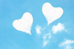 two heart shaped clouds on blue sky Stock Photos