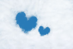 two heart shaped clouds on blue sky Royalty Free Stock Photography
