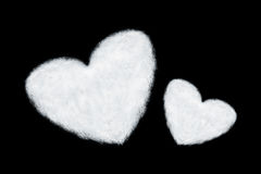 two heart shaped clouds isolated on black Stock Image